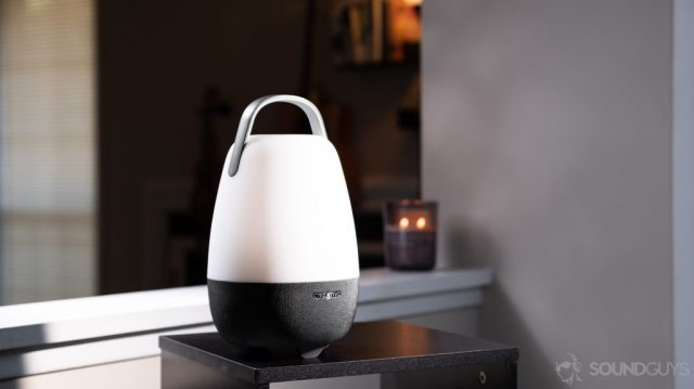 The speaker in a living room setting with a candle lit in the background.