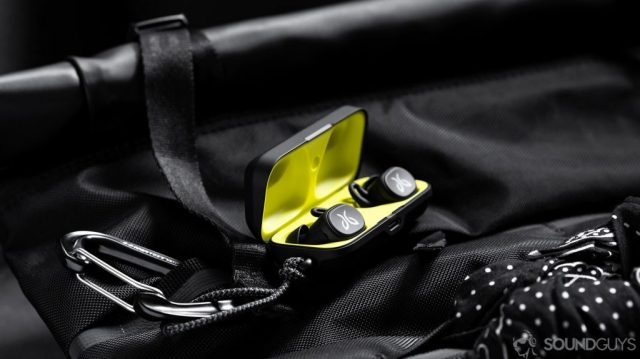 An image of the Jaybird Vista, an alternative to the Jabra Elite 75t, in charging case which is open and on a Chrome backpack.