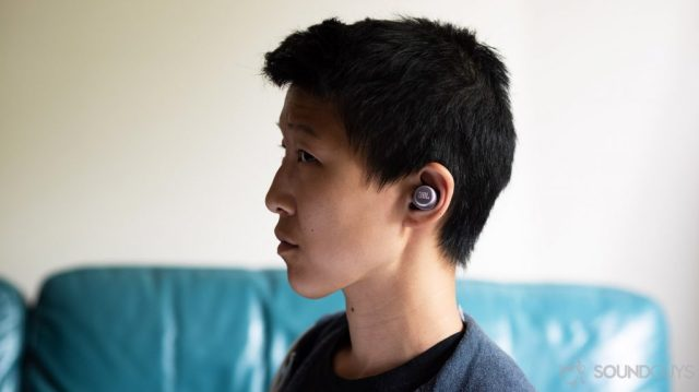 A picture of the JBL LIVE 300 TWS true wireless earbuds being worn by a woman in profile.