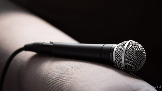 A photo of the Shure SM58 on the arm of a couch.