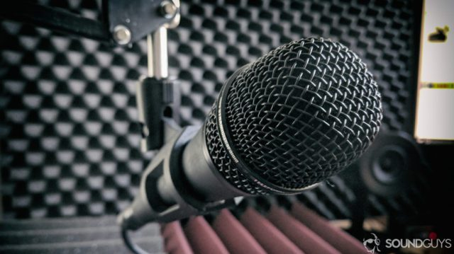 A photo of a microphone in a recording studio.