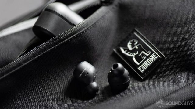 A picture of the Panasonic Technics RZ-S500W noise cancelling earbuds on a Chrome sling bag with the case angled in the zippered pocket of the bag.