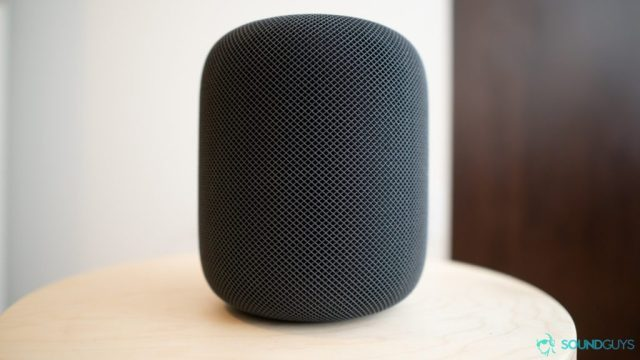 A picture of the Apple HomePod smart speaker on a wooden table.