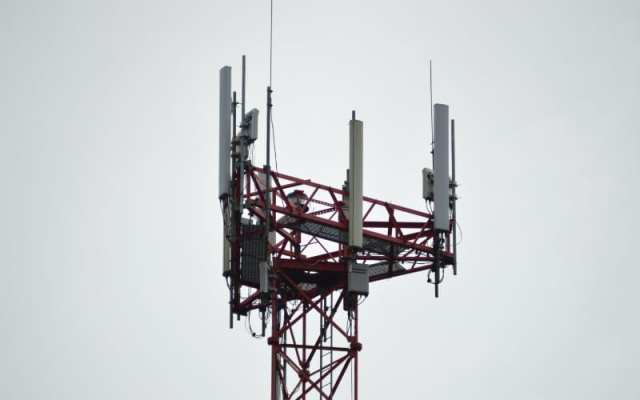 Cell tower against white sky
