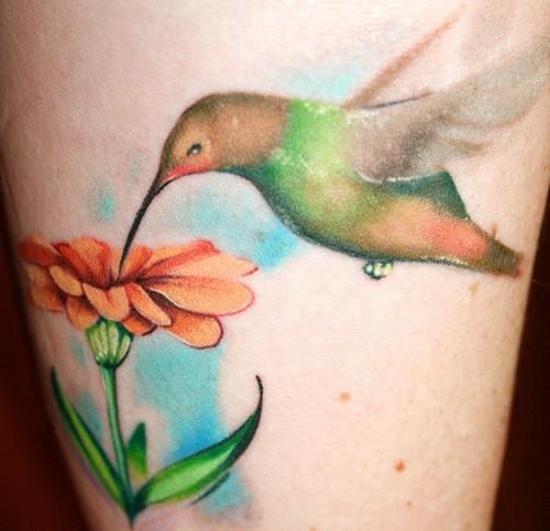 hummingbird-and-flower-thigh-tattoo