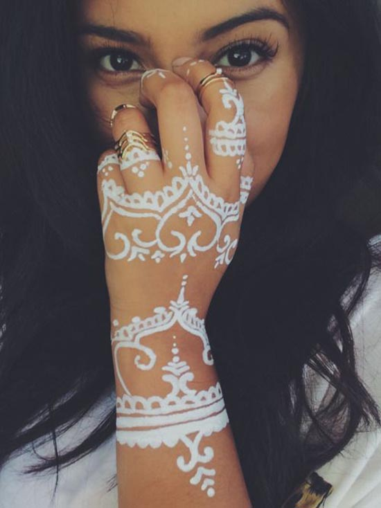 hidden face henna tattoos ideas