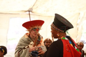 A bride receives a blanket during a Zulu wedding