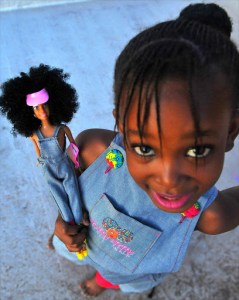 A young girl showing off her Mommpy Mpoppy doll