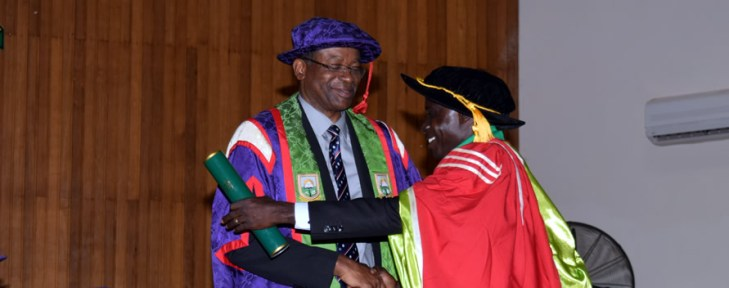 Dr Lewis Brew being Congratulated by the Vice Chancellor