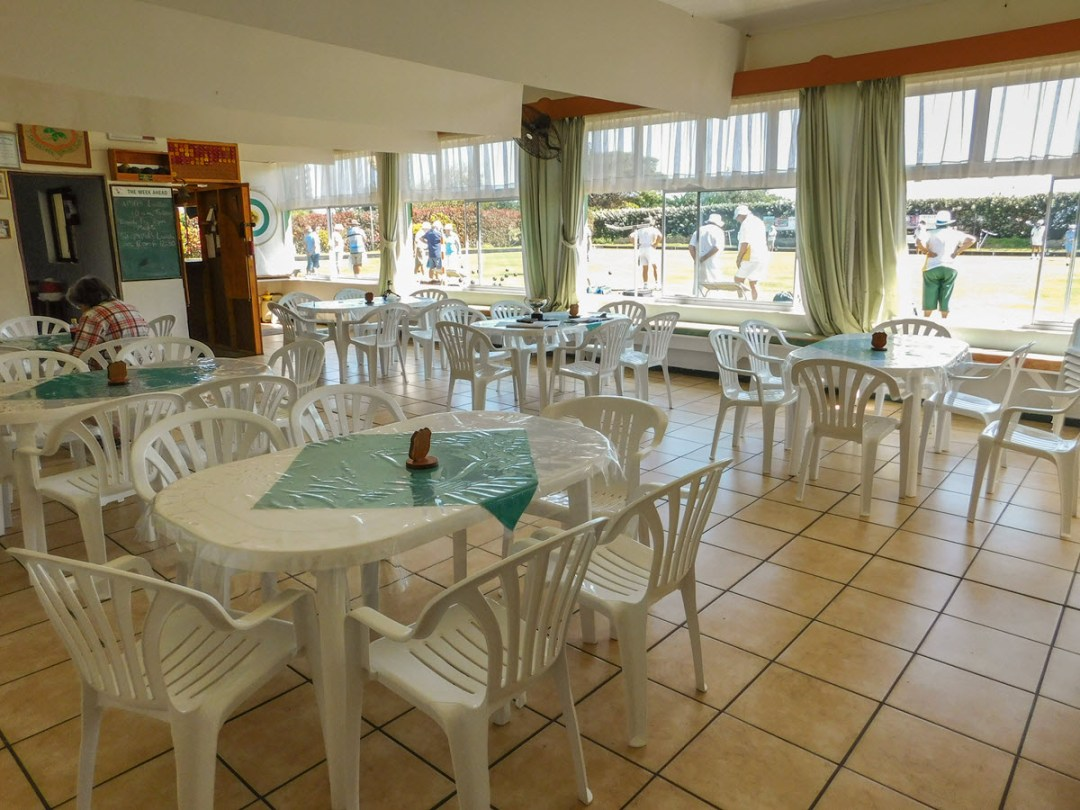 Clubhouse indoor venue space with tables and chairs