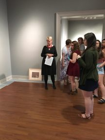 Students in the Laboratory in Museum Studies course discuss the layout and design of the exhibit.