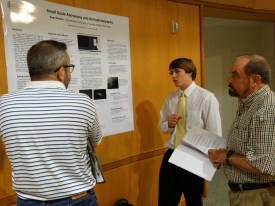 Ryan Barlow, middle, explains his research on astrophotography.