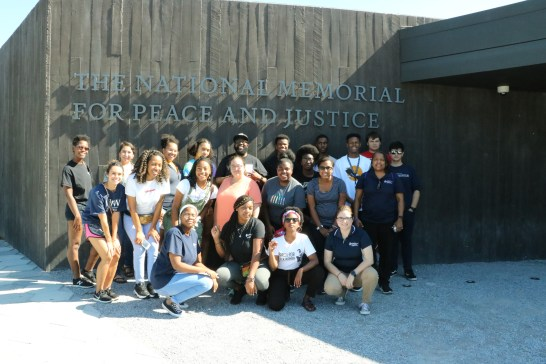 Mehari (front row, second from right) poses with UMW students in front of the Legacy Museum in Montgomery.
