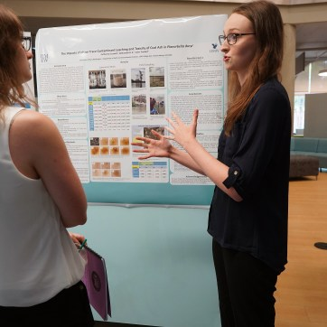 UMW student Catherine Crowell explains her research on trace contaminant leahing and the toxicity of coal ash. The 10-week Summer Science Institute allows students to work for hours per day on their research. Photos by Suzanne Carr Rossi.