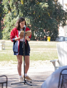 UMW sophomore Katia Savelyeva reads aloud from emily m. danforth's 'The Miseducation of Cameron Post.' Books like this involving LGBT characters or themes are frequent targets of censorship. Photo by Matthew Binamira Sanders.