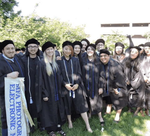Tyler, with her grad school classmates, prepares to receive her MFA. At UMW, she switched focus, from biology to art, when a class she had with Professor Carole Garmon helped her realize she could make a paycheck while also pursuing her passion.