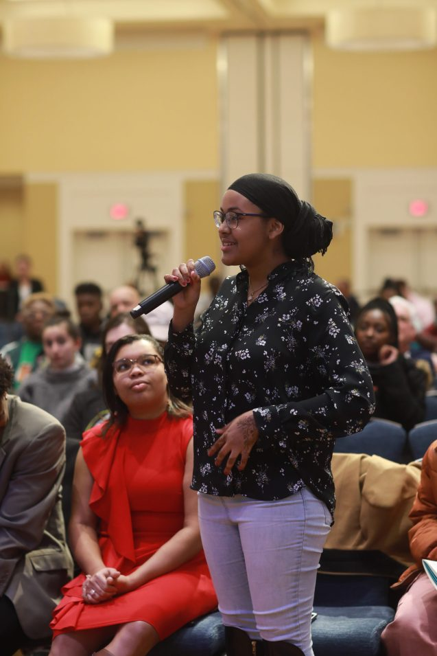 Bilqiis Sheikh-Issa, vice president of UMW's NAACP chapter asks a question during the Dr. Martin Luther King keynote address in January. Photo by Karen Pearlman.
