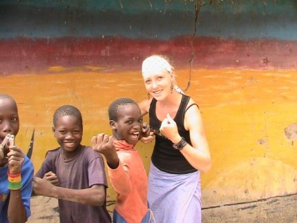 Laura Mackey '06 said she was one of three UMW alumni who were Peace Corps volunteers in Senegal from 2006 to 2007. Here she jokes around with local children in Dar Salam, between the Kédougou and Tambacounda regions.