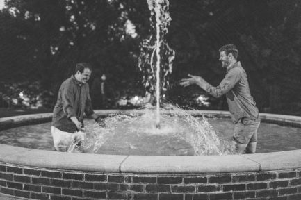 Evan Smallwood (left) and Aaron McPherson enjoy a uniquely Mary Washington perk - playing around in the Palmieri Fountain. The two wed on campus last year.