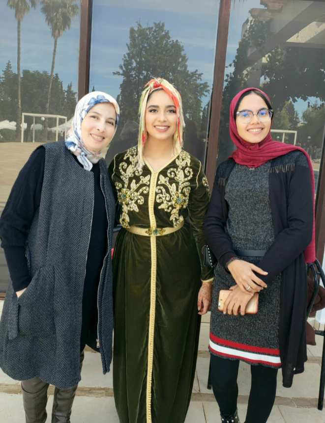 Amal Hajjami (center), on the day she was sworn in as a Peace Corps volunteer in Morocco, with Btissam Errifai (left), director of a local women's center where Hajjami works, and Zineb El Hani Provental (right), director of the Peace Corps' Youth in Development program in Morocco. Hajjami will spend the next two years teaching English, Spanish and life skills to Moroccan women and youth, and also teaches preschool at the women's center.