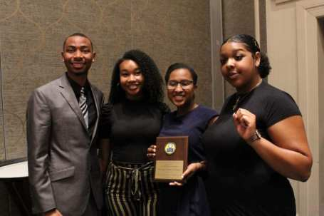 "From left to right, Blake Barnes, former president of the Virginia NAACP's Youth and College Division, poses with UMW student Khaila Nelson, UMW NAACP former president Kelsey Chavers '19 and current president Brianna Reaves at the Virginia State Conference, where the NAACP at UMW chapter won the ""On Your Way"" award."