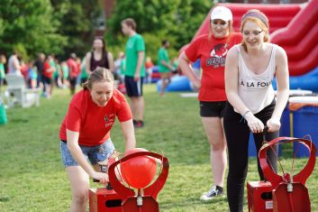UMW students participate in a balloon-inflating competition during the 2019 Devil Goat Day celebration. Photo by Suzanne Carr Rossi.
