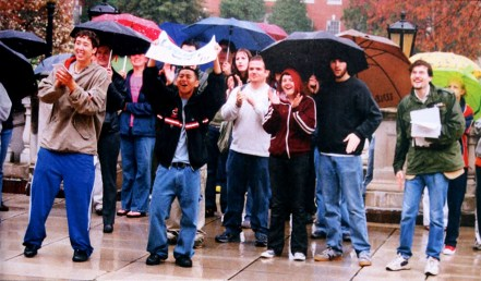 In 2004, a group of students gathered in the rain in front of Lee Hall to support the Living Wage campaign. Photo courtesy of UMW Libraries' Special Collections and University Archives/Battlefield Yearbook.