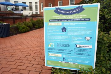 "Signs across campus remind students to follow guidelines, such as ""MMDC"" - monitoring, masking, cleaning and distancing. Photo by Suzanne Rossi."