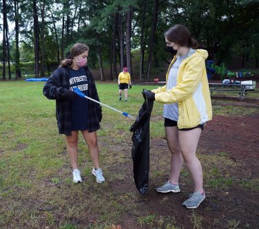 From left to right: Hannah Abraham and Jenna Montgomery help Friends of the Rappahannock by picking up trash in Kenmore Park. Photo by Suzanne Carr Rossi.