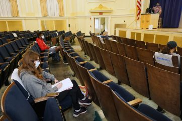 Dodd Auditorium in George Washington Hall is typically reserved for presentations and performances. The 1,200-seat venue is being used as a socially distanced classroom space during the pandemic. Photo by Suzanne Carr Rossi.