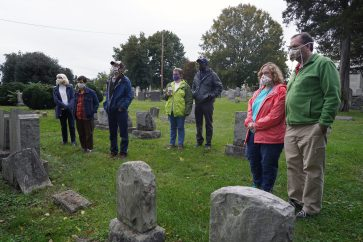 Small groups spread out on this socially distanced tour, which replaced the Historic Preservation Club's popular Ghostwalk this year. Photo by Suzanne Carr Rossi.