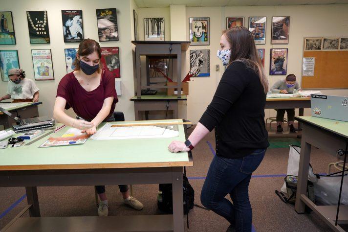 Junior Sean Coady draws in Bridgette Dennett's Scenic Design course.