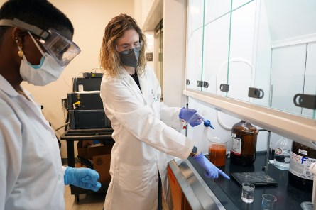 """When people think about chemistry, they often think of scientists in lab coats and goggles with smoking beakers as they are portrayed on TV and movies. It really is much more than that,"" said Smith, shown here, explaining to Ebenki, a UMW student, how to extract capsaicin and dihydrocapsaicin from Maltese's Signal One 2.0 beer. ""Just about every single product we purchase has been subjected to chemistry to make sure it is safe and within set guidelines."" Photo by Suzanne Carr Rossi."