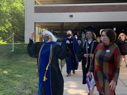 From left to right, Provost Nina Mikhalevsky, BOV member Ted Hontz, Lillian Lester '20 and Special Assistant to the President for University Events Susan Worrell head onto the field before one of nine UMW Commencement ceremonies throughout four days.