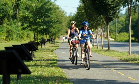 Bikers pass by the StoryWalk(R) project along the Rappahannock Heritage Trail. The project, which was started in Vermont, has been recreated in all 50 states and various countries across the globe. Photo by Suzanne Carr Rossi.