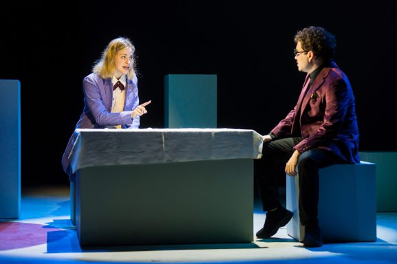 Shannon Hardy, who plays Barbara, converses with Oscar León in 'Nickel and Dimed.' Photo by Geoff Greene.