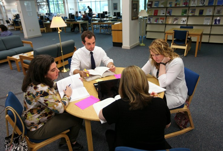 A class working at the Stafford Campus library.