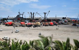 Photo: Somalia's seaport bustles with business as trucks come to off load ships of their cargo.