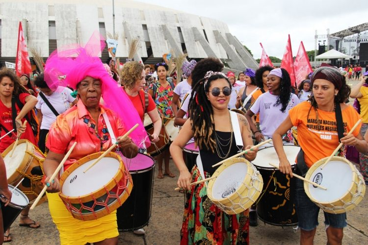 Photo: women take part in the Black Women's March against Racism and Violence in Brasilia, Brazil, on 18 November 2015.