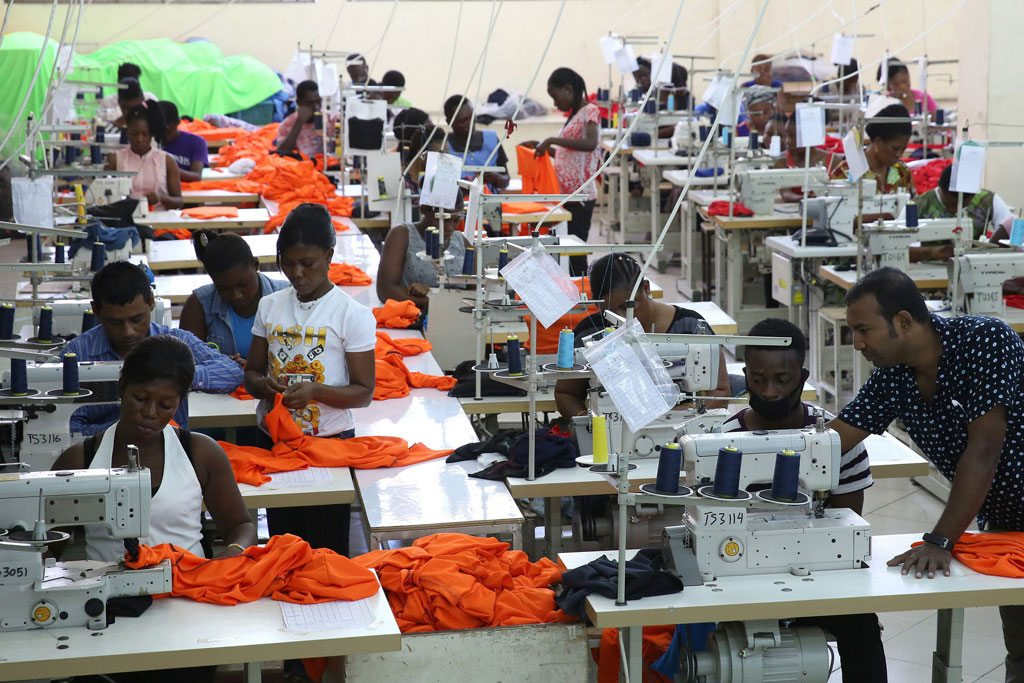 Photo: Factory workers in Accra, Ghana, produce shirts for overseas clients.