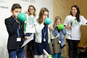 Photo: Participants play a game at Youth Day at #COP21 in Paris.