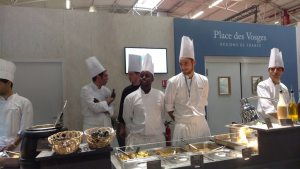 Photo: Chefs at Le Bourget, site of the COP21, prepare to serve food on 11 December.