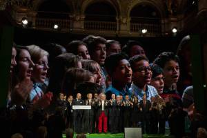 Photo: Children sing at the closing of the Climate Summit for Local Leaders in Paris.