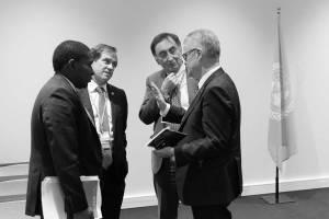 Photo: Senior advisers to Ban Ki-moon speak before a meeting with U.S. Secretary of State John Kerry.