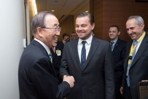 Photo: Ban Ki-moon greets Leonardo DiCaprio at the Paris Agreement Signing Ceremony.