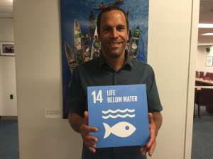 Photo: Musician Jack Johnson takes a moment for Goal 14 ahead of a World Oceans Day performance.