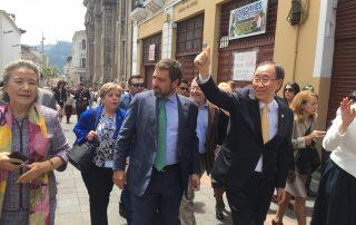 Photo: Secretary-General Ban Ki-moon waves to Ecuadorians as he walks through old Quito.