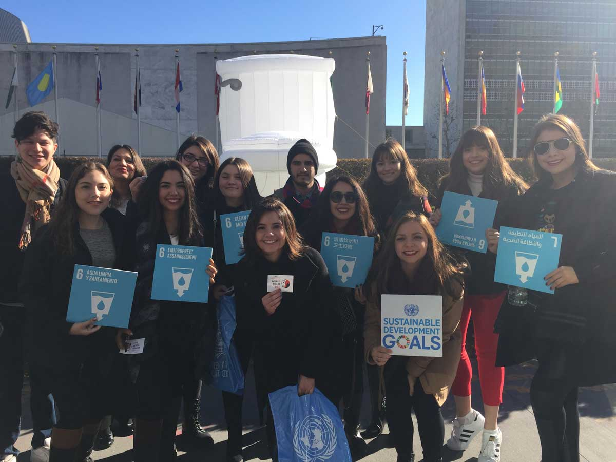 Photo: Students from Mexico pose near a giant inflatable toilet set up for World Toilet Day outside UN headquarters in New York.