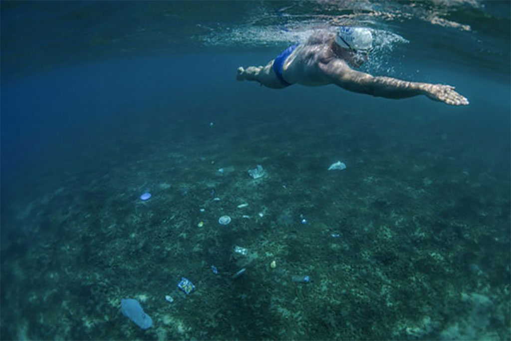 UNEP Patron for Oceans, Lewis Pugh, is swimming the Seven Seas to urge policy makers to protect at least 10 per cent of the world's seas. In the Arabian Sea off Oman, the seabed was a rubbish dump. No fish. No coral. Just tyres, plastic packets, bottles, cans. Photo: UNEP
