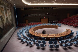 A Conference Officer at work in the Security Council Chamber, ahead of a Council meeting. UN Photo/Kim Haughton